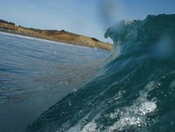 A breaking wave at Fossil Beach. Image