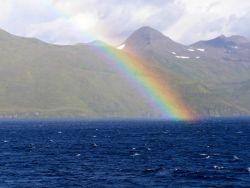 A brilliant rainbow seen from the NOAA Ship MILLER FREEMAN at Dutch Harbor. Image