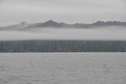 A ribbon of fog bisects Little Diomede Island. Image