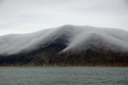 Fog filling ravines at Cape Prince of Wales. Photo