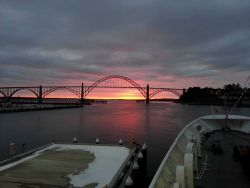 Looking through the Yaquina Bay Bridge at the setting sun. Photo