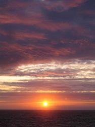 Sun setting over the ocean. Photo