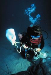 Aquanaut uses a buoy to signal the surface and raise equipment. Image
