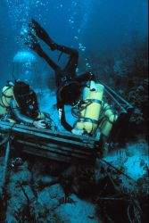Aquanauts change out tanks near the Aquarius undersea laboratory. Image