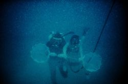 Bongo nets deployed by divers to collect marine snow. Photo