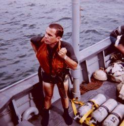Scuba Divers and Wet Suits - Exploring the Seas Photo