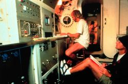 Aquanaut works at computer inside AQUARIUS. Image