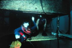 Aquanaut enters the wet porch of AQUARIUS. Image