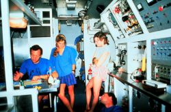 AQUARIUS aquanauts discuss dive plan during coral feeding study. Image