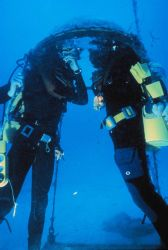 AQUARIUS aquanauts pause to converse in talk bubble. Image