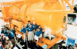 After complete overhaul, AQUARIUS is christened and readied for sea. Image