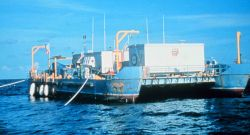 Manned AQUARIUS Support Barge was replaced by a Life Support Buoy in 1997. Photo