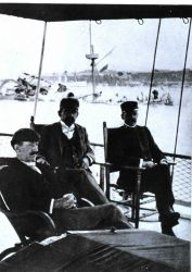 Unidentified officers sitting on the stern of the Coast and Geodetic Survey Ship BACHE in Havana Harbor on February 16, 1898 Photo