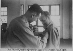 Major Marvin Paulson receiving Army Meritorious Service Ribbon for service in the Philippines helping in the reconstruction, clearing, and recharting  Photo