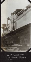 Lieutenant Charles Pierce and Ensign Leonard Johnson as passengers on a logging train in British Northwest Borneo during fueling stop in Sandakan. Photo