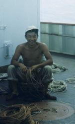 Fisheries scientist Bell Shimada making up lines for catching fish for further study. Photo