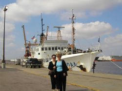 NOAA Central Library head cataloger Anna Fiolek and head of reference Dorothy Anderson in front of NOAA Ship OREGON II at Pascagoula, Mississippi. Photo