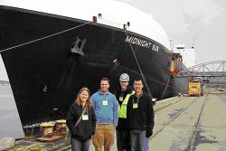 Alaska National Weather Service employees Louise Fode, Todd Foisy, Larry Hubble, and Tom Dang visit the containership M/V Midnight Sun Image