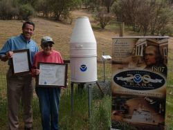 Dave Reynolds, Meteorologist in Charge at the NWS WSFO in Monterey, presents Clorene Akers with the Benjamin Franklin Award for 55 years of voluntary  Photo