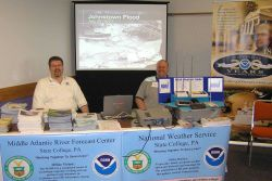 Peter Jung, Senior Hydrologist, and William Gartner, Forecaster, staff a booth at the Open House hosted by the co-located NWS Forecast Office and Midd Photo