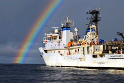 The NOAA Ship McArthur II watches the remnants of Hurricane Henrietta fade into the distance as it conducts research operations 250 miles SW of Manzan Photo