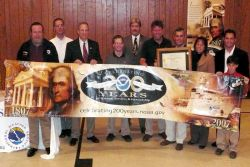 An award ceremony for Doug Hollier, National Weather Service volunteer cooperative weather observer Image