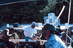 In the foreground, John Iliff, the NOAA project manager for the restoration at Mona Island prepares to dive. Photo