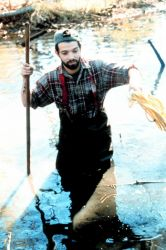 Andy Lipsky of Save the Bay, RI staff assists with the clean-up of Mussachuck Creek. Photo