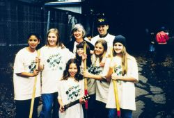 A group of volunteer school children are photographed with representative Lynn Woolsey. Photo