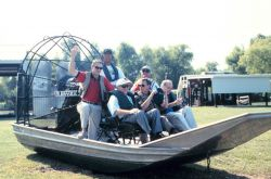 Senator Breaux and other dignitaries prepare for an air boat tour of the restoration project. Photo