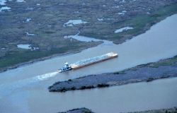 An aerial view of the tug pushing a barge load of rock up Locust Bayou. Photo