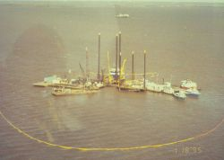 An aerial view of the boom used to contain the spill at Dixon Bay. Photo