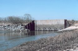 The tide gate at the mouth of Army Creek on the Delaware side of the river Photo
