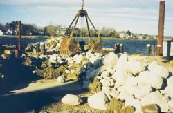 Loading reef construction materials onto barges for transportation to the reef sites Photo