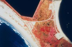 A color infrared aerial of Sachuest Marsh looking upstream and downstream prior to restoration. Image