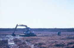 A distant view of the specialized ditch digger at work. Image
