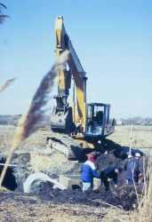 A series of images show the placement of the new culvert at Sachuest Marsh. Image