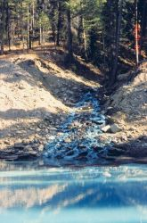 The distinct blue in this image is caused by copper contamination, Bucktail Creek Photo