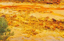 Acid mineral deposits in the Debris Dam, Iron Mountain Mine. Image