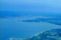 A distant view of Fairhaven and New Bedford Harbor with Sconicut Neck on the right Image