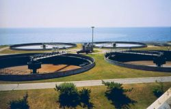 Sewage treatment plant settling tank at the southern tip of Clarks Point Photo