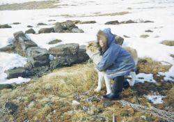 An Eskimo with a sled dog. Image