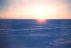 A winter sunset over the North Slope - note the parallel ridges in the snow Photo