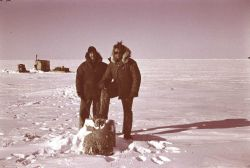 Bill Love and Ensign Harley Nygren At Leffingwell survey monument Photo