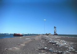 Survey boat at the Long Island camp - Shoran navigation antenna on the beach Photo