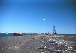 Survey boat at the Long Island camp - Shoran navigation antenna on the beach Photo