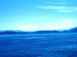 A crystal clear day from near the San Juan Islands Mount Baker visible in the distance Photo
