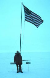 United States flag marks the geographic South Pole. Photo