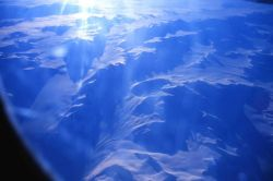 Passing over coastal Antarctic mountains on the way to McMurdo Sound Station. Photo