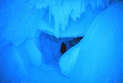 Ice spelunker in cave passageway at Erebus Glacier tongue Photo